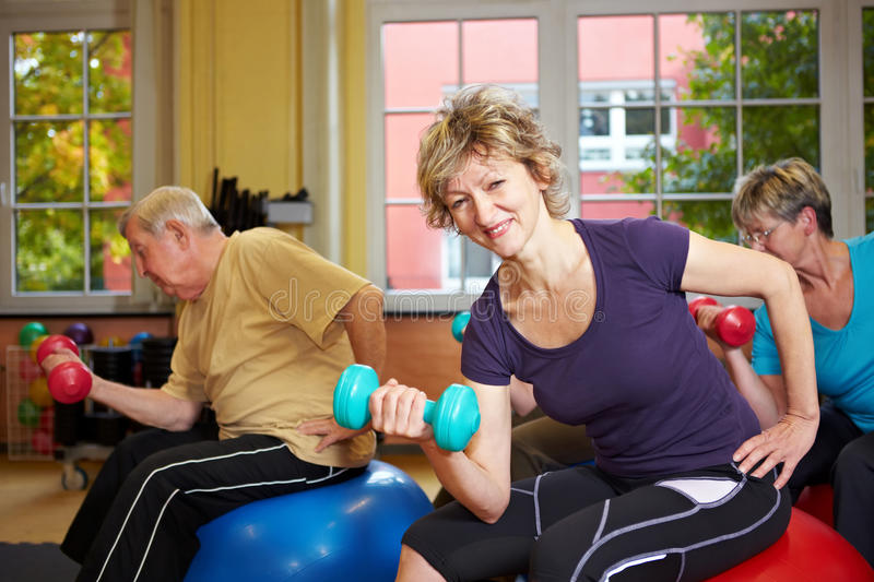 Download Group Exercising With Dumbbells Stock Image - Image of center, pensioner: 17214929