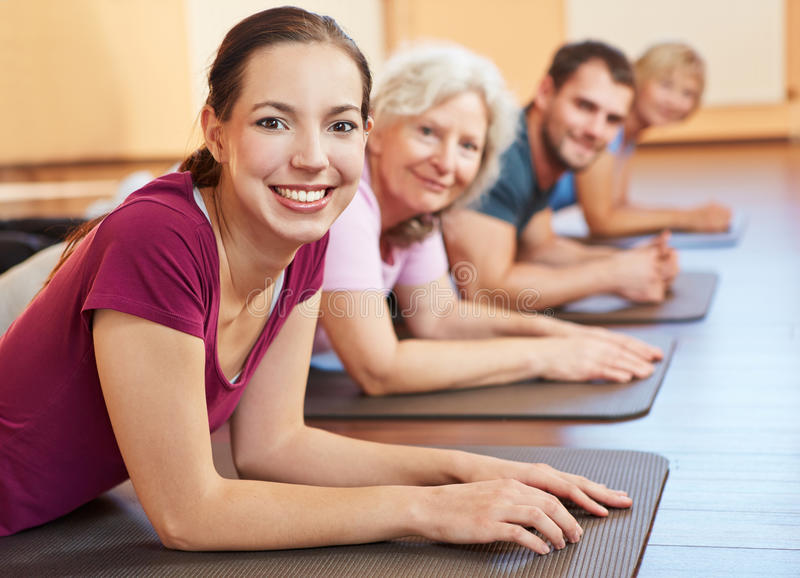 Download Group exercising in gym stock image. Image of center - 27675343