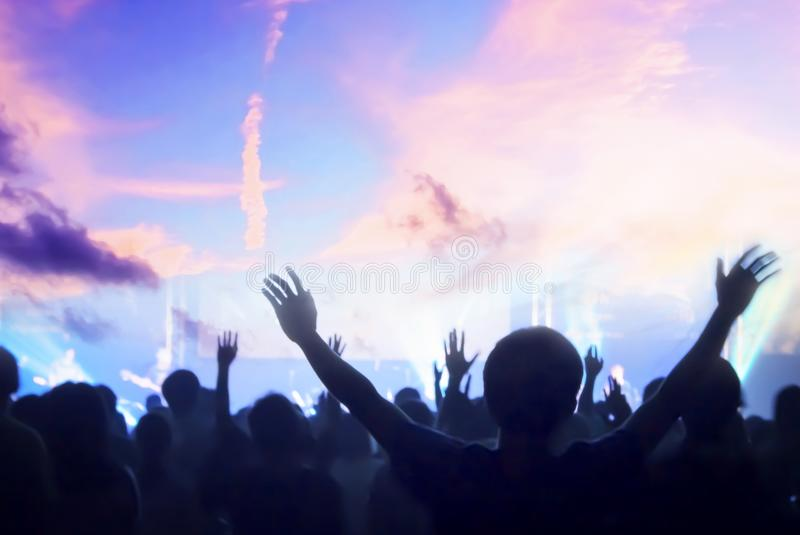 Raise your hands and worship God stock photo