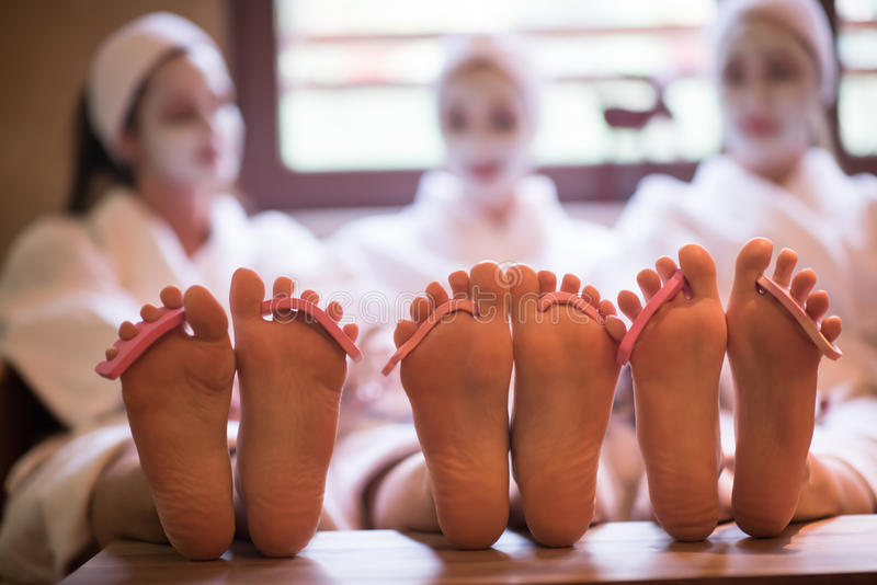 Group of famale friends in spa. Have fun, celebrate bachelorette party with face mask stock photos