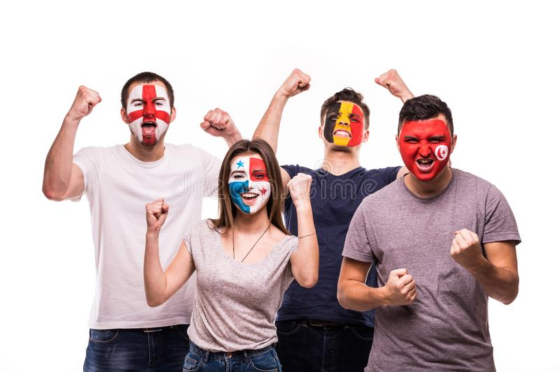 Group of fans suport their national teams with painted faces. England, Belgium, Tunisia, Panama Fans victory scream isolated on wh royalty free stock image