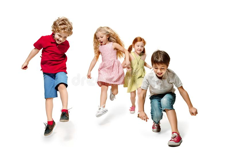 Group of fashion cute preschooler kids friends running together royalty free stock photo