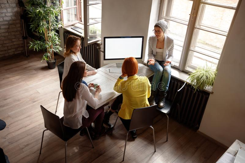 Group of fashion designer working and talking at studio royalty free stock image