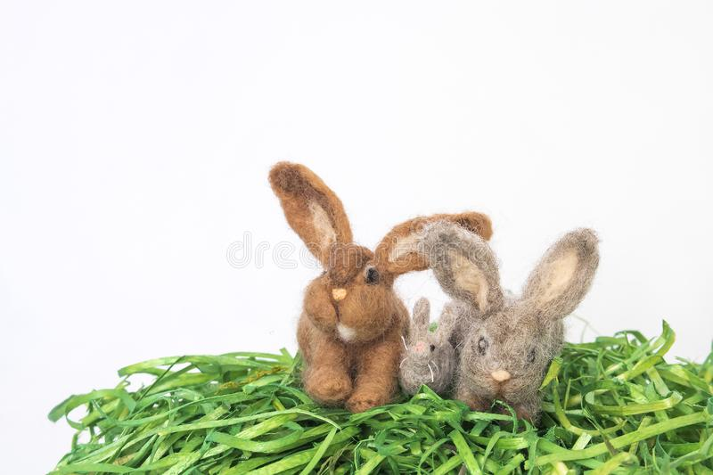 Group of Felted Wood Bunnies or Rabbits on White Background stock photos