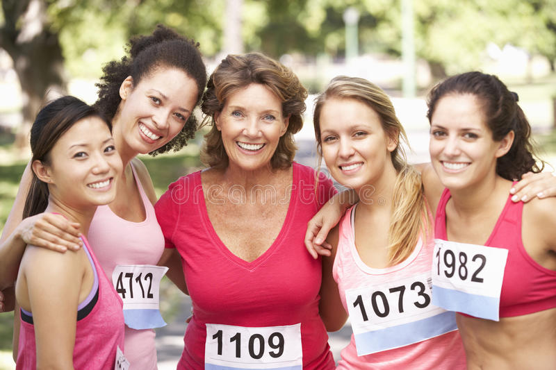 Group Of Female Athletes Competing In Charity Marathon Race royalty free stock images