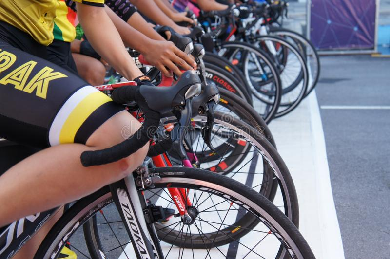Group of female cyclists are ready to be on the starting line. royalty free stock image
