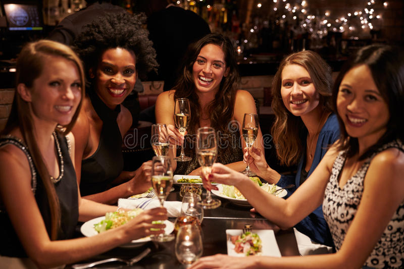 Group Of Female Friends Enjoying Meal In Restaurant stock photography