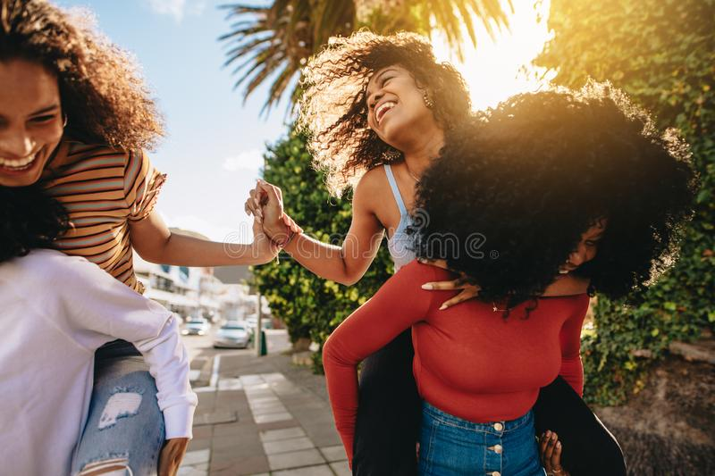Girls playing around in the city royalty free stock photos