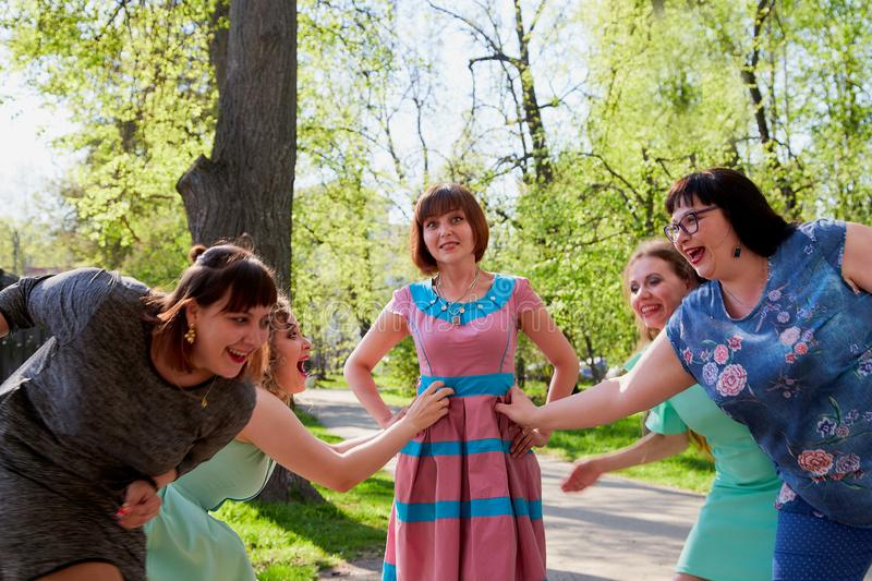 Group of female friends walking in the park stock photos