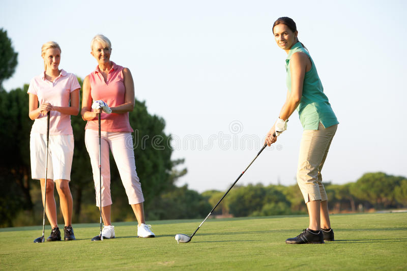 Download Group Of Female Golfers Teeing Off Stock Photo - Image of course, young: 16305378