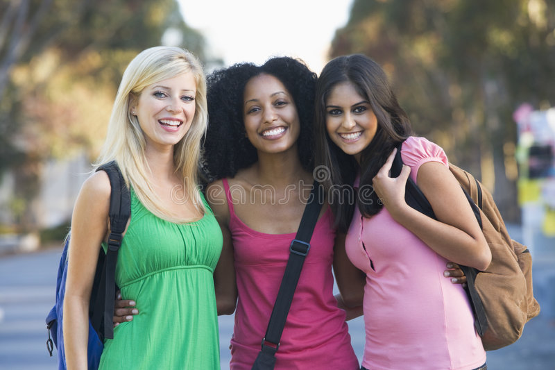 Group of female students having fun royalty free stock image