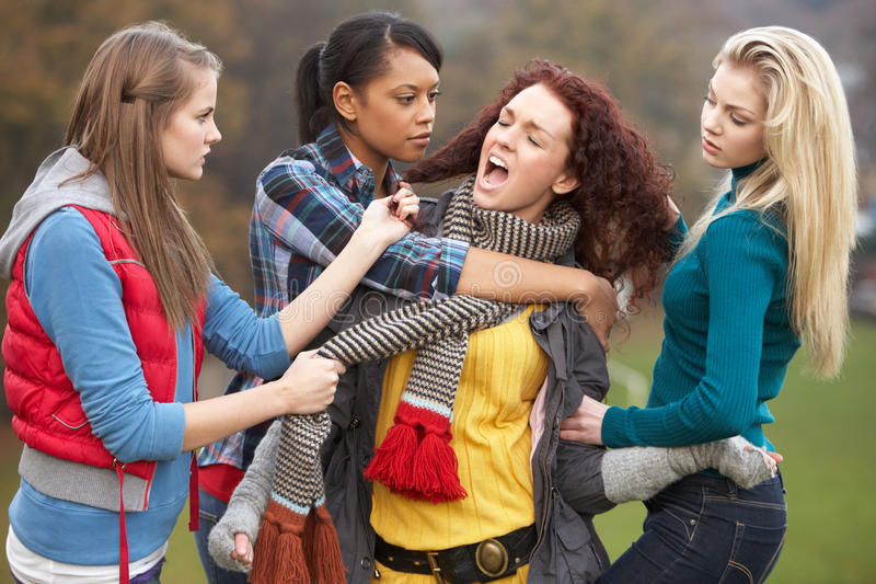 Group Of Female Teenagers Bullying Girl royalty free stock image
