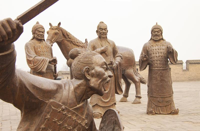 Group of fighting figures at the ancient city wall of Pingyao, Shanxi Province, the last remaining intact Ming Dynasty city wall i. N China. Pingyao, China stock images
