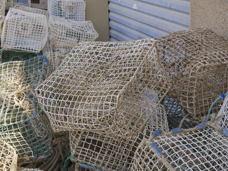 Group of fish and shellfish traps in a port, ready to be carried in a fishing ship.  stock photos