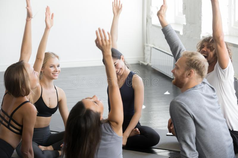 Group of sporty happy people voting yoga lesson stock photography