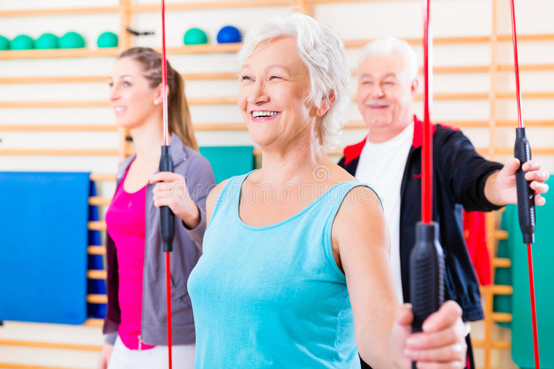 Group at fitness training with gymnastic bar royalty free stock image