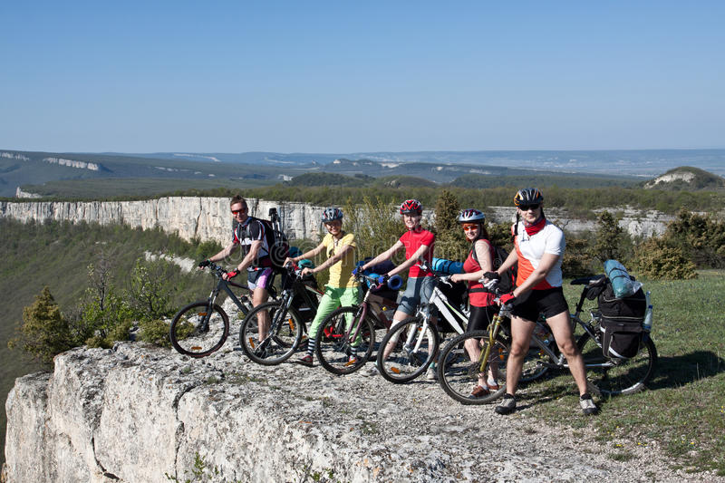 A group of five adults on bicycles. royalty free stock image