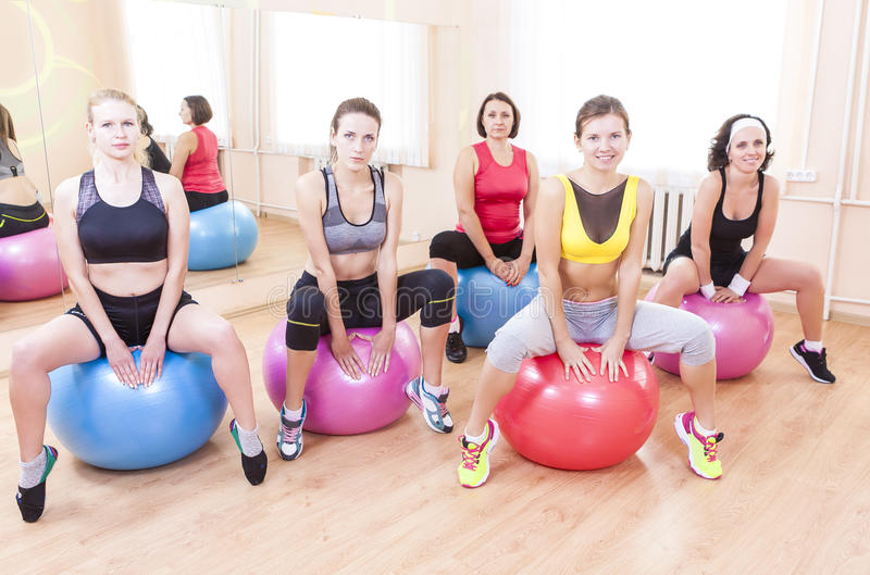 Group of Five Caucasian Female Athletes Having Exercises With Fitballs royalty free stock photography