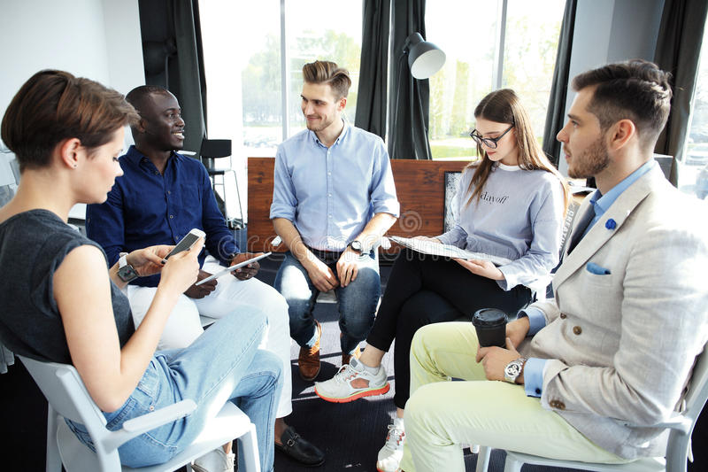 Group of five creative worker brainstorm together in office, new style of workspace, happy scene of people in office stock photos