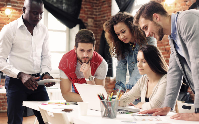 Group of five creative worker brainstorm together in office, new style of workspace, happy scene of people in office stock images