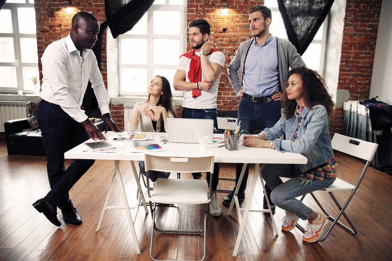 Group of five creative worker brainstorm together in office, new style of workspace, happy scene of people in office royalty free stock images