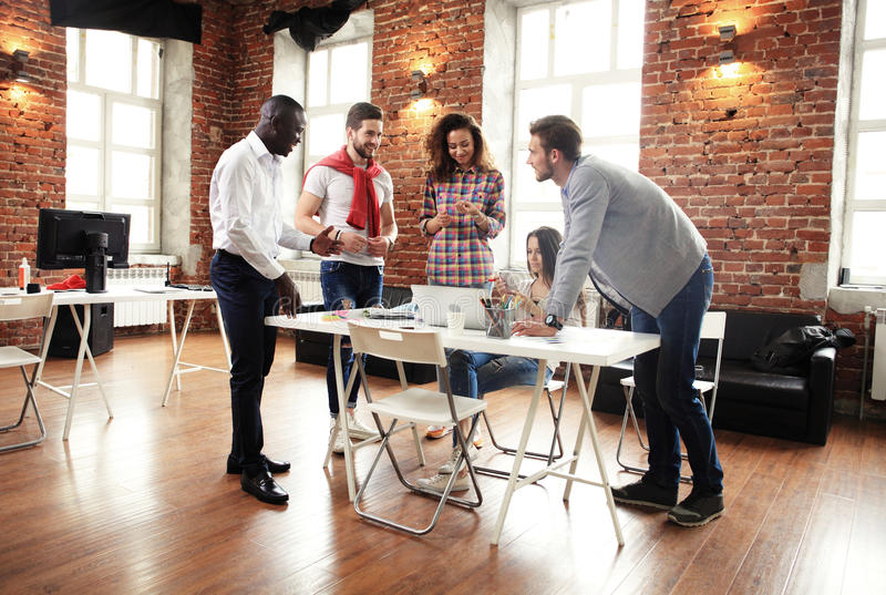 Group of five creative worker brainstorm together in office, new style of workspace, happy scene of people in office stock photo
