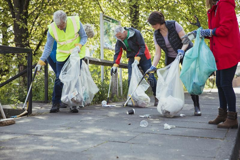 Picking Up Litter Together royalty free stock photography