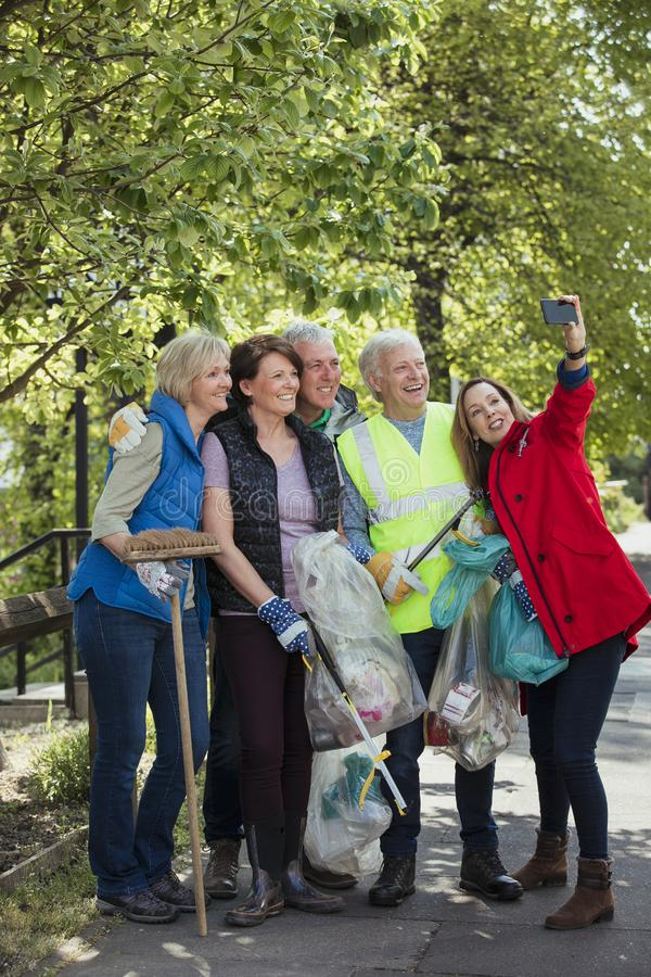 City Cleaners Taking a Selfie. A group of five people who are participating in a city clean-up taking a selfie stock image