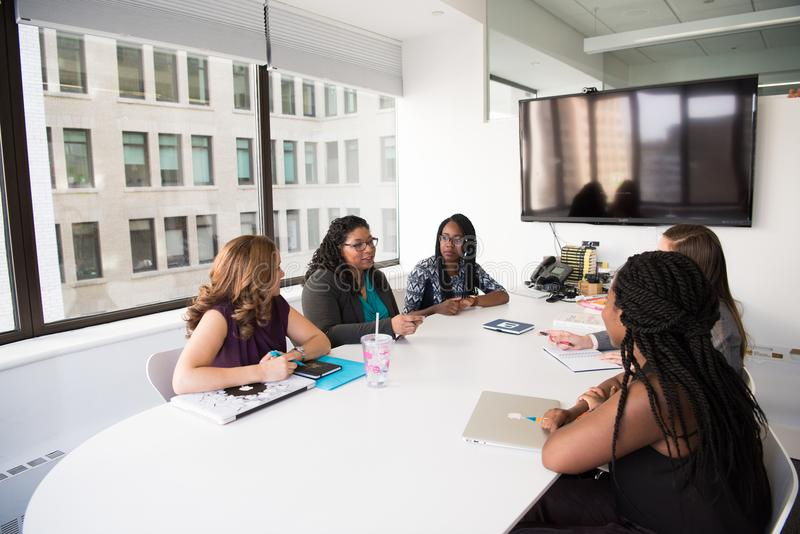 Group of Five Women Gathering Inside Office royalty free stock image