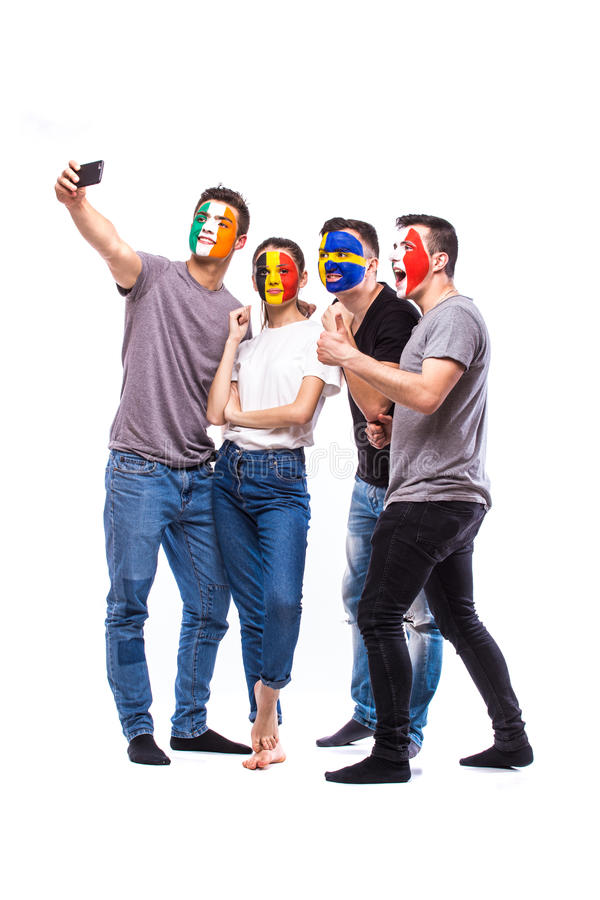 Group of football fans support their national team: Belgium, Italy, Republic of Ireland, Sweden take selfie photo stock photos