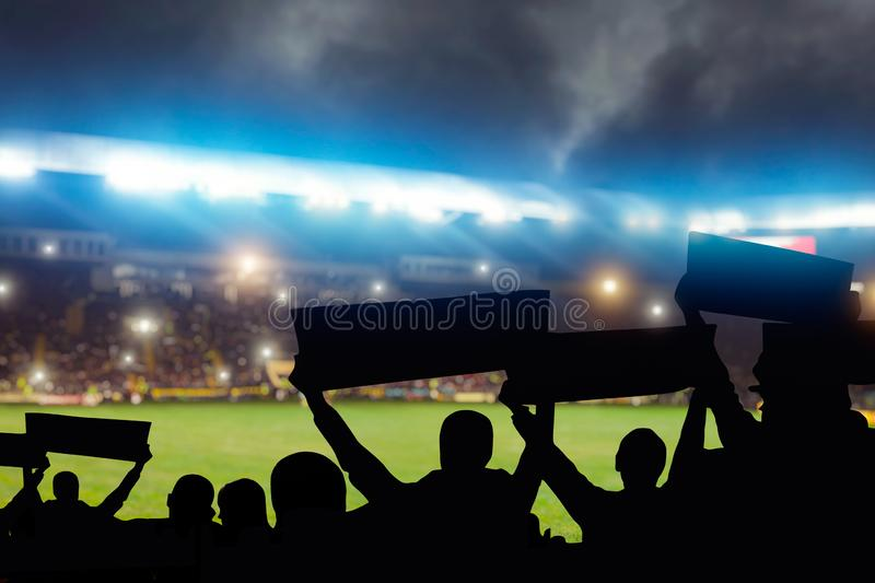 Group of football fans on tribune, back view royalty free stock photo