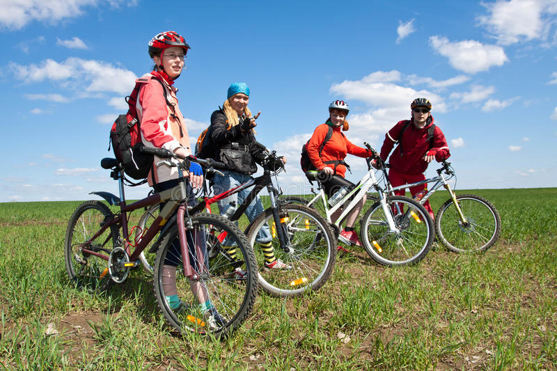 A group of four adults on bicycles. stock photo