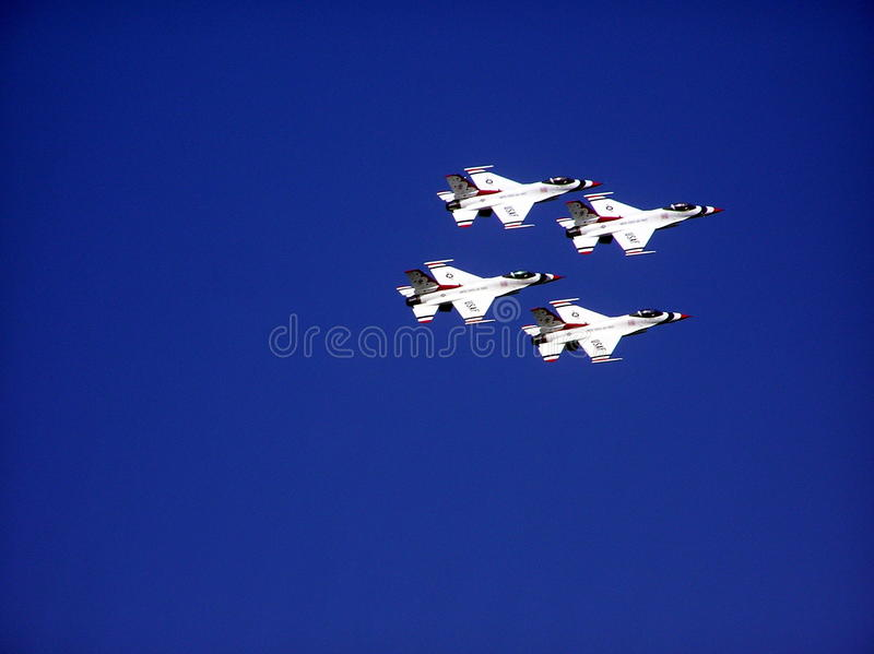 Group of four fighter jets flying in formation royalty free stock photos