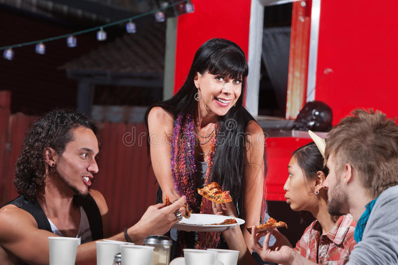 Four Happy People Eating Pizza stock photos
