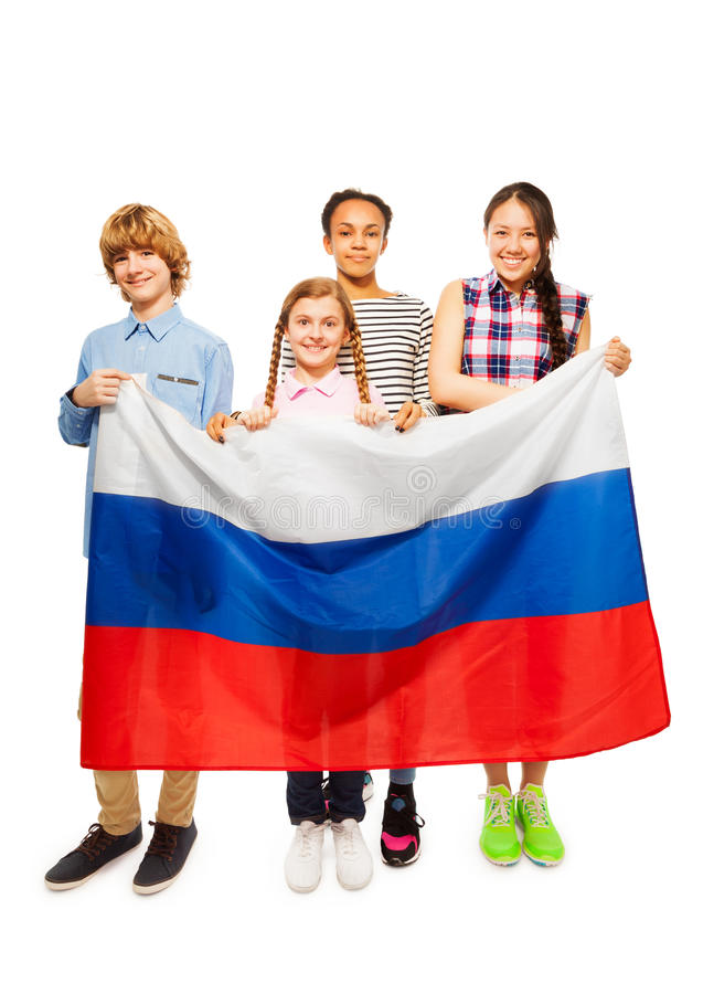Group of four happy teenage kids with Russian flag. Group of four happy multiethnic teenage kids standing behind Russian flag, isolated on white stock photography