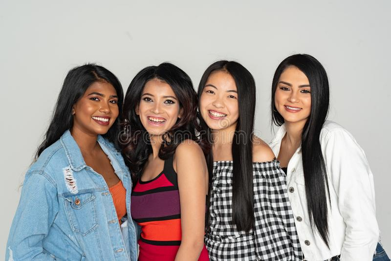 Group of Four Minority Friends Together stock images
