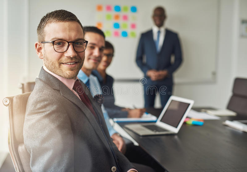Group of four people in conference meeting stock photography