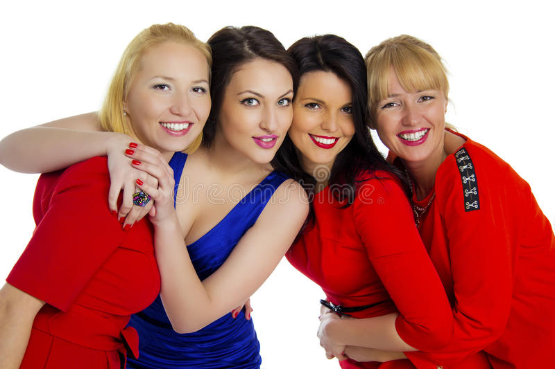 Group of four sexy, beautiful young happy women. Isolated on white royalty free stock photo