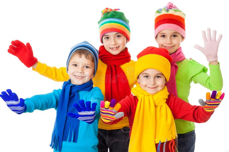 Group of smiling kids in winter clothes royalty free stock photo