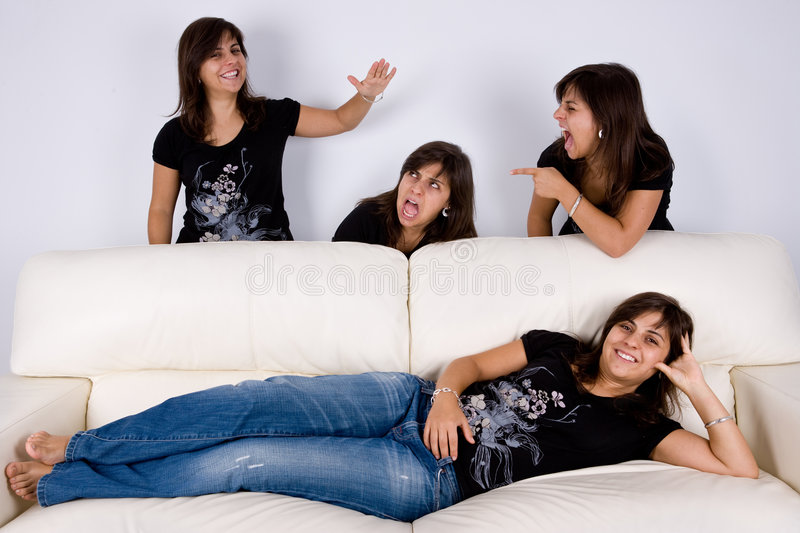 Group of four twins having fun indoors royalty free stock photo