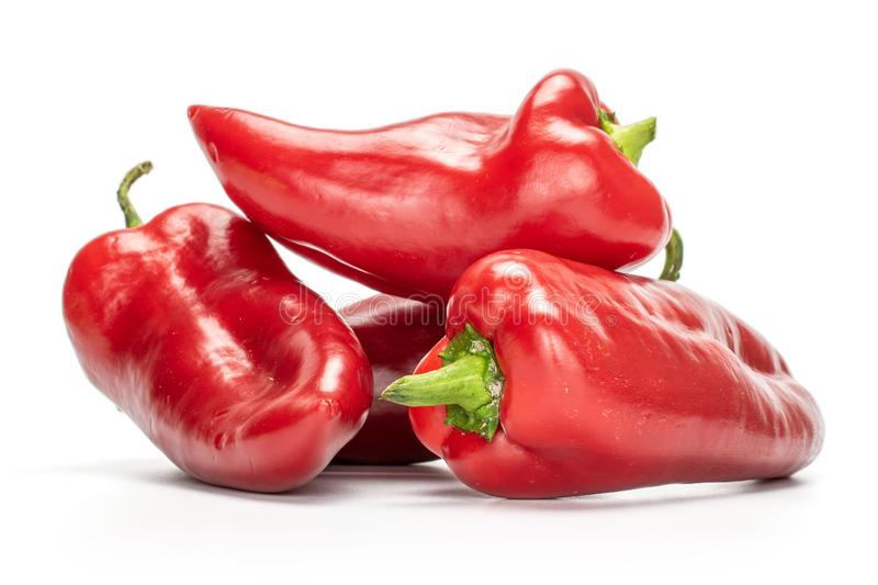 Sweet red bell pepper isolated on white. Group of four whole sweet red bell pepper isolated on white background royalty free stock photography