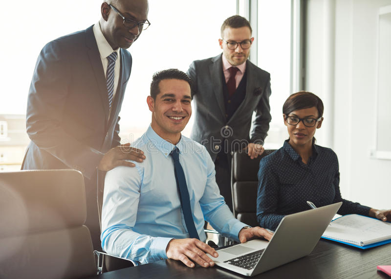 Group of four young business people in office stock photos