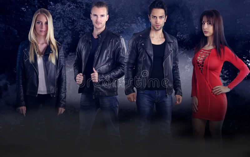 Group of four young vampires stock photography