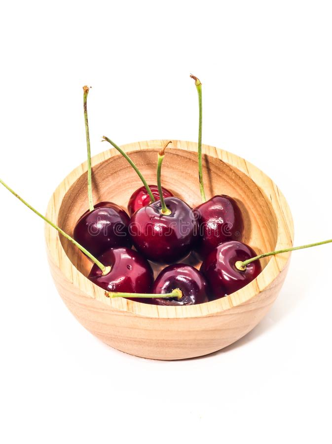 Group Fresh cherry on brown wooden cup stock photography
