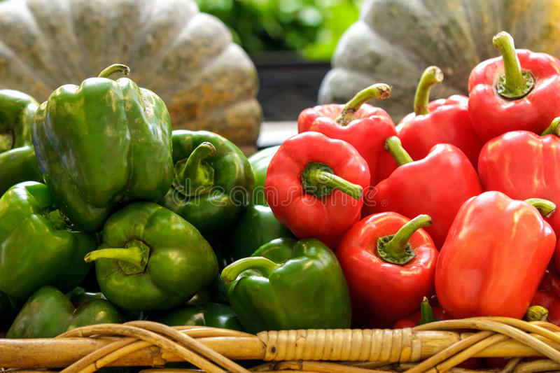 A group of fresh green and red bell peppers stock photo