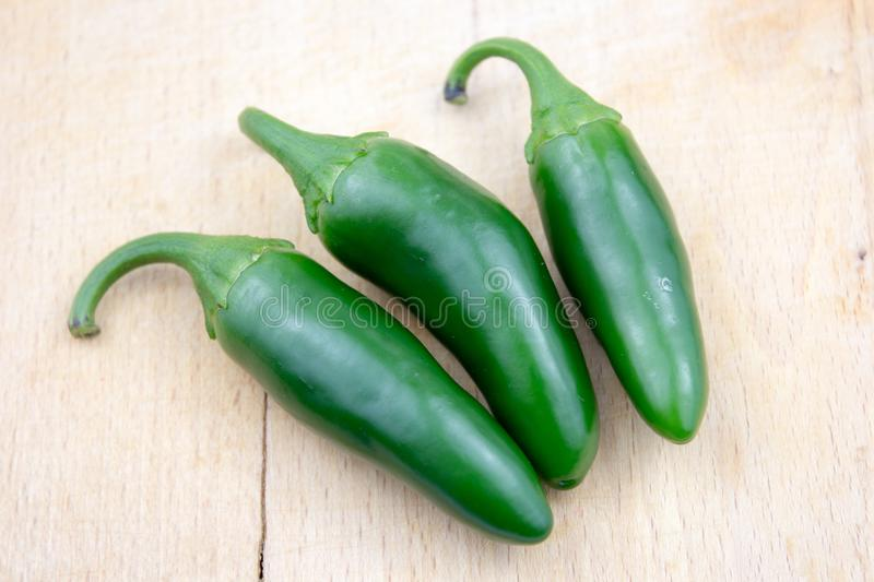 Group of fresh, healthy jalapeno peppers. From my garden. isolated background, multiple uses is possible stock photo