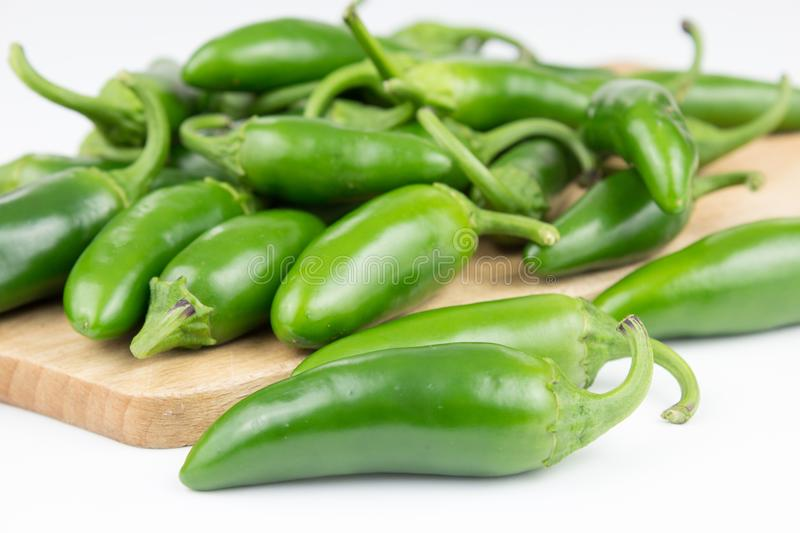Group of fresh, healthy jalapeno peppers. From my garden. isolated background, multiple uses is possible royalty free stock image