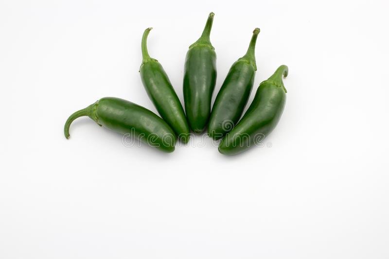 Group of fresh, healthy jalapeno peppers. From my garden. isolated background, multiple uses is possible royalty free stock photography