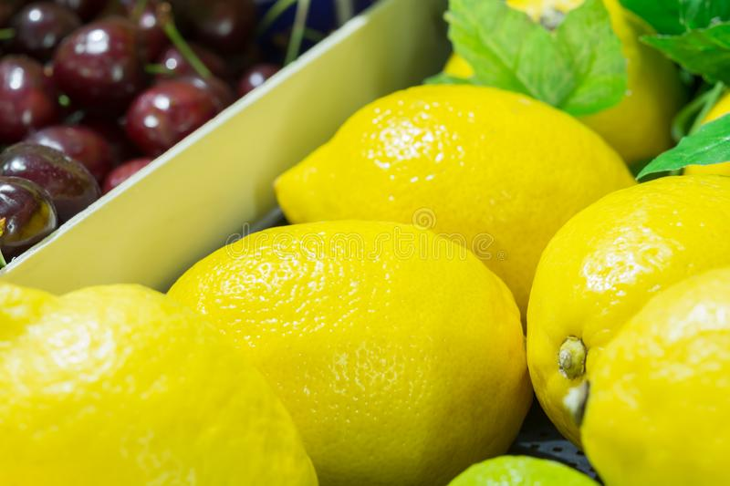 Group of fresh lemon and cherries close up royalty free stock photos