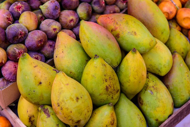Group of fresh mango and figs royalty free stock image